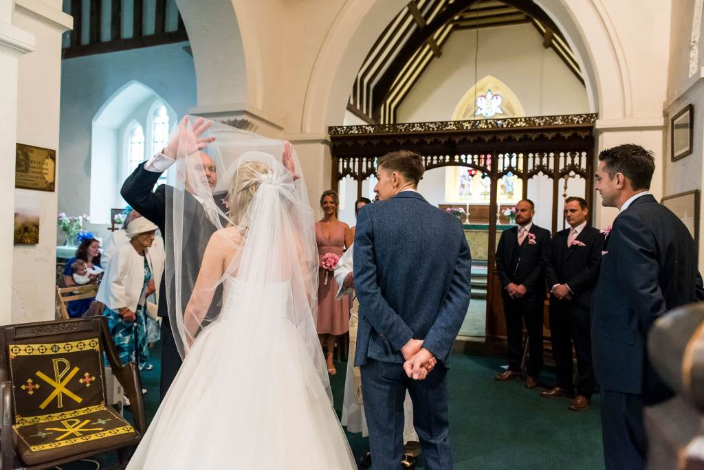 father of the bride takes off his daughters veil