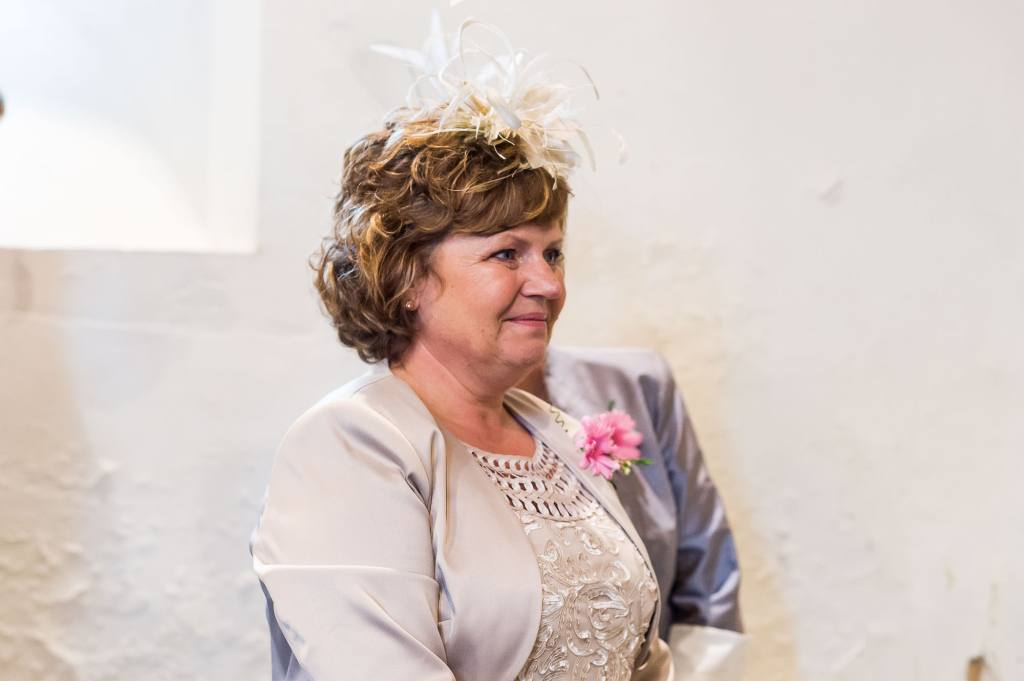mother of the bride smiles lovingly