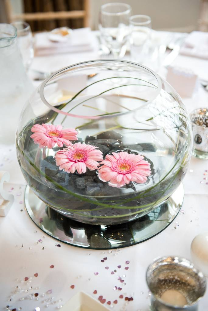 pink flowers floating in water feature