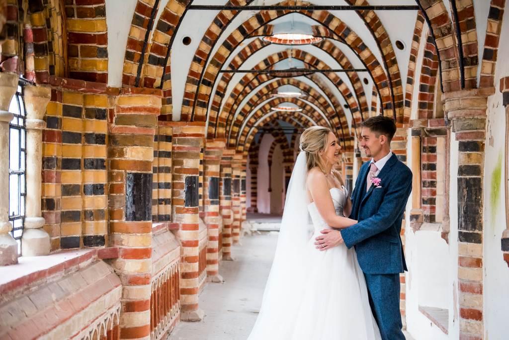 st martha's wedding, bride in strapless dress looks lovingly at her groom