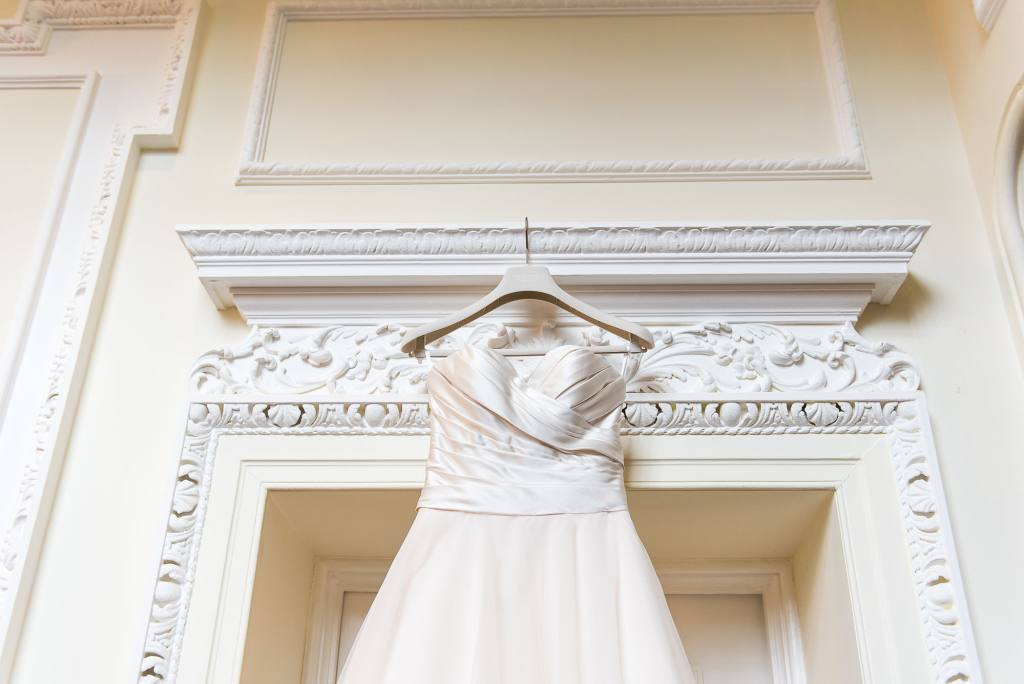 wedding dress hanging on the door at Horsley Towers