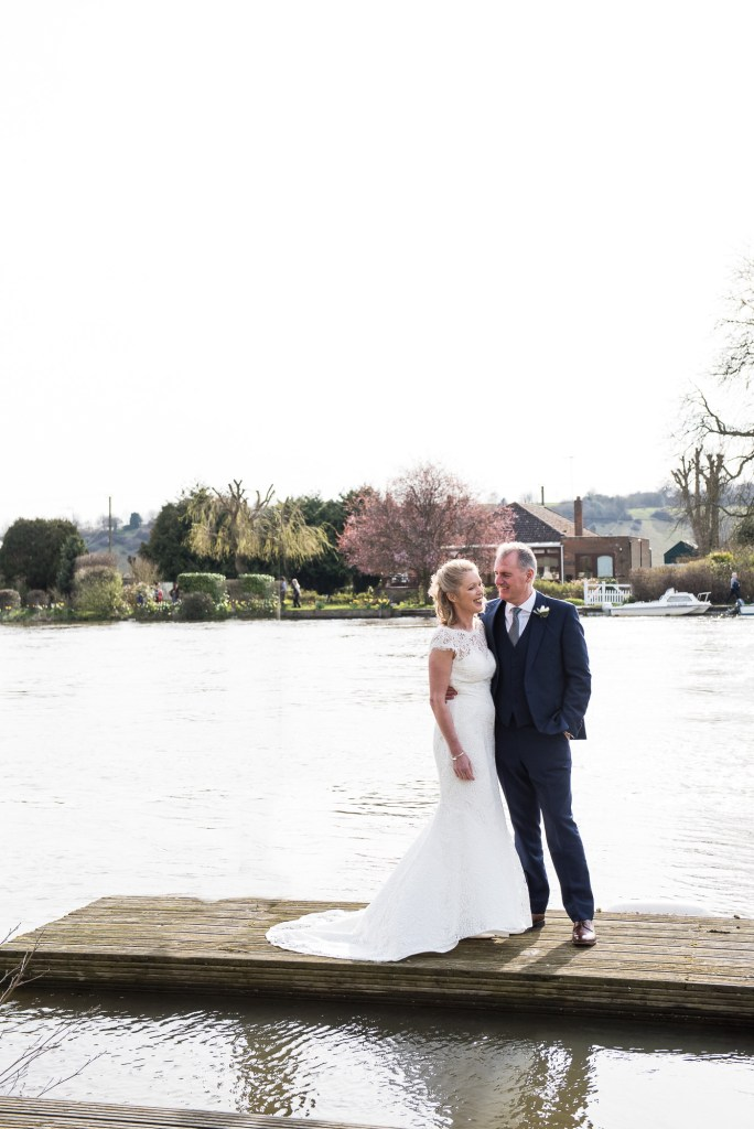 Couple stand together on s dock, Marlow wedding photography