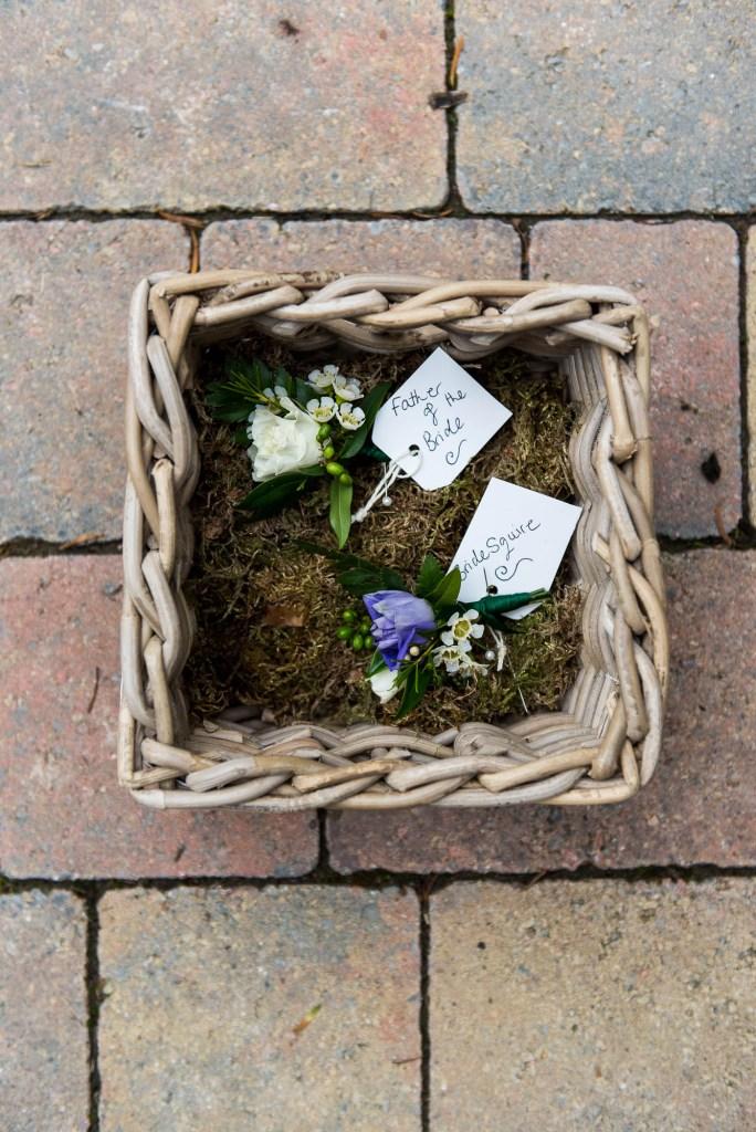 Purple flower arrangements for wedding button holes