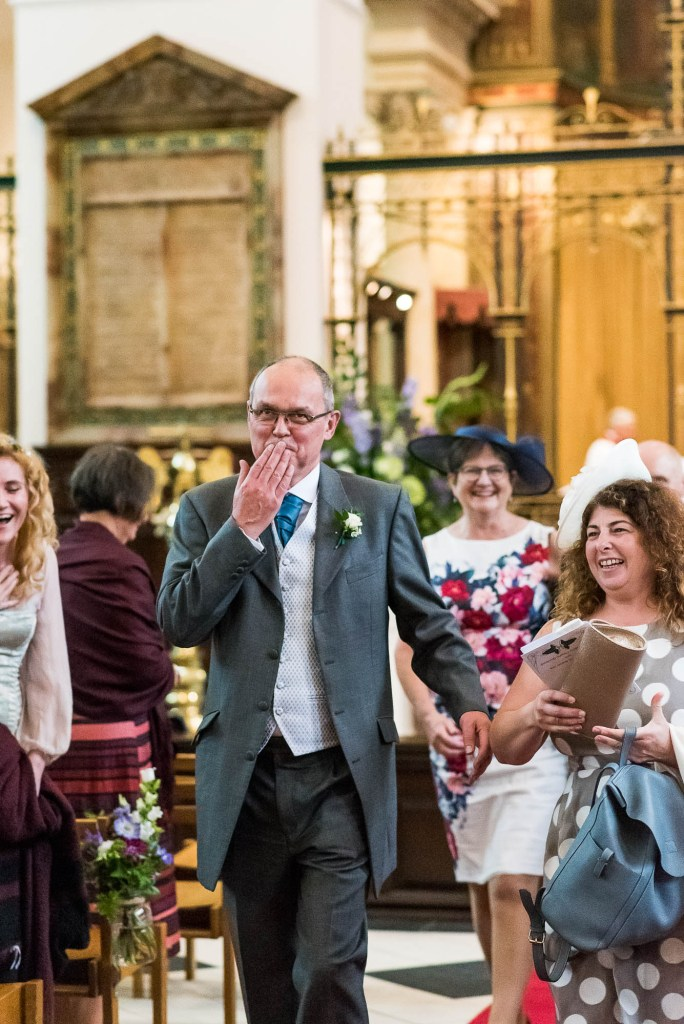 Father of the bride blows a kiss