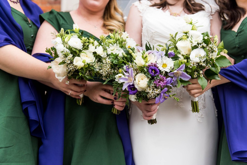 Bridal bouquets together in a line