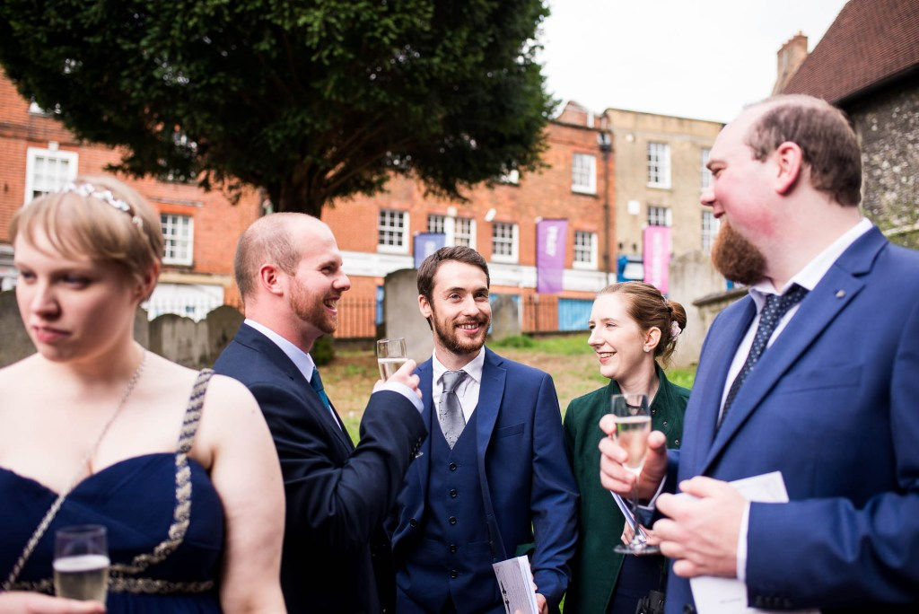 Candid and documentary style photography capturing guests at the reception