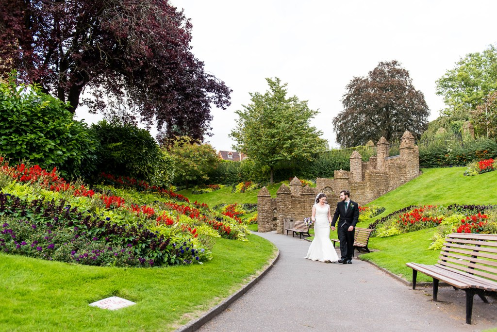Couple walk through Guildford Castle gardens together