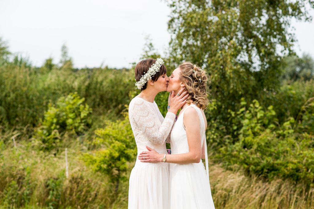 natural wedding phootgraphy // same sex couple kiss passionately