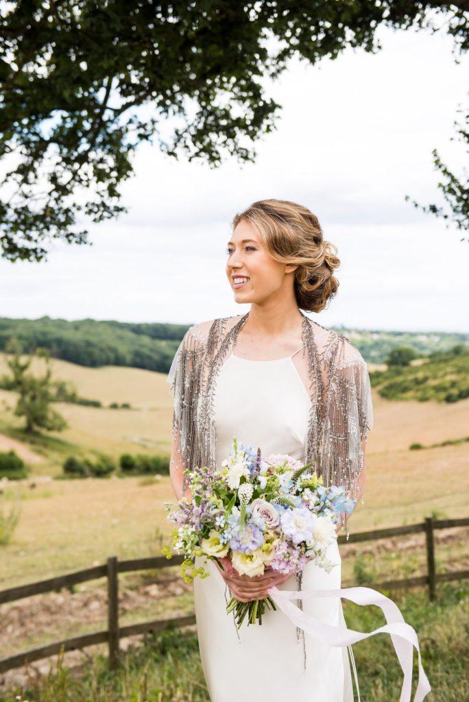 Surrey bride in a silk wedding dress and sequin shawl