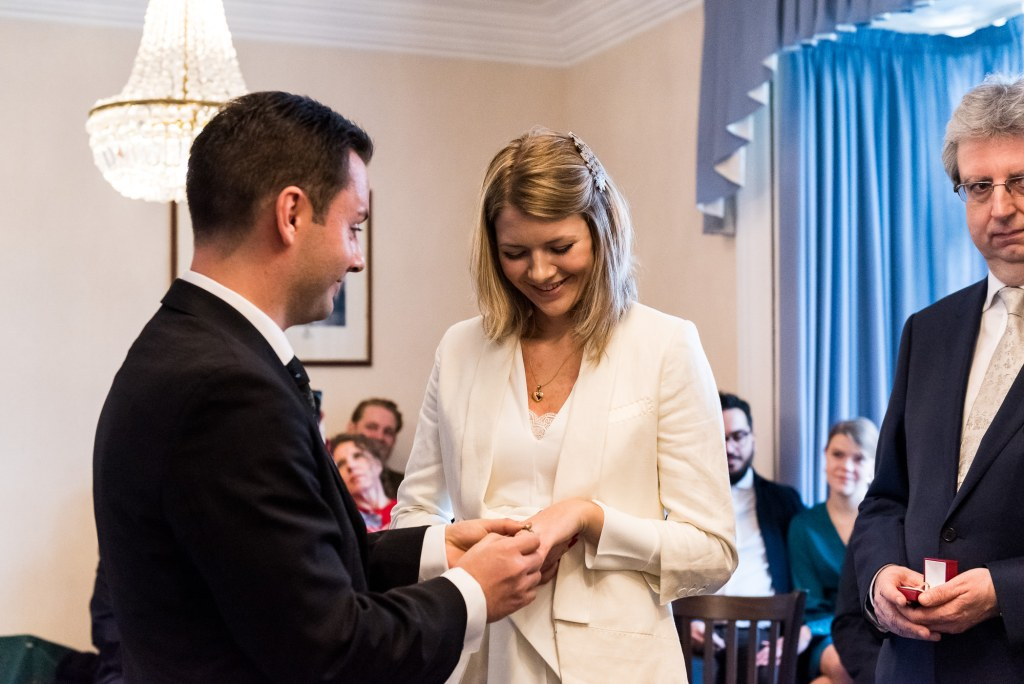 Natural wedding photographer Surrey - the moment the rings are exchanged