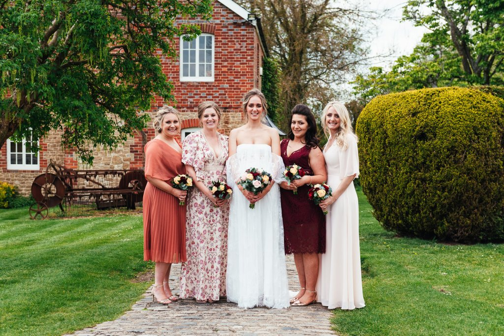 Autumnal coloured bridesmaid dresses with a Grace Loves Lace bride