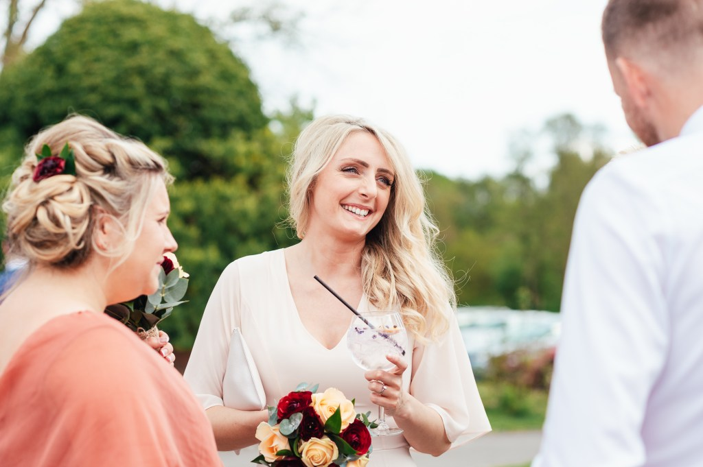 Candid bridesmaid photo at Spring Surrey The Mill at Elstead wedding