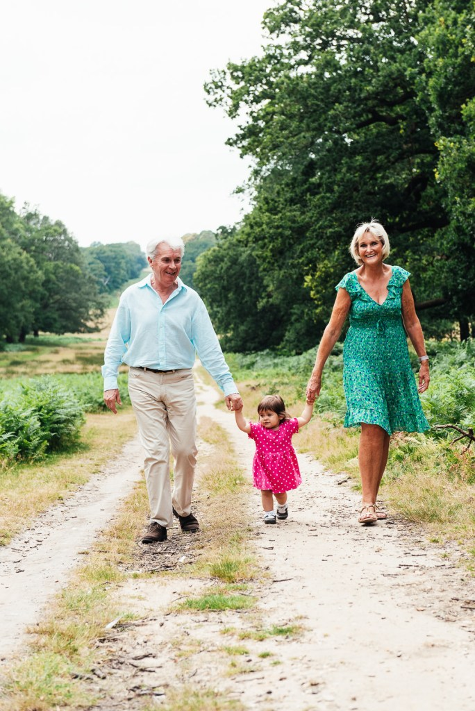 Grandparents walk together through Richmond Park