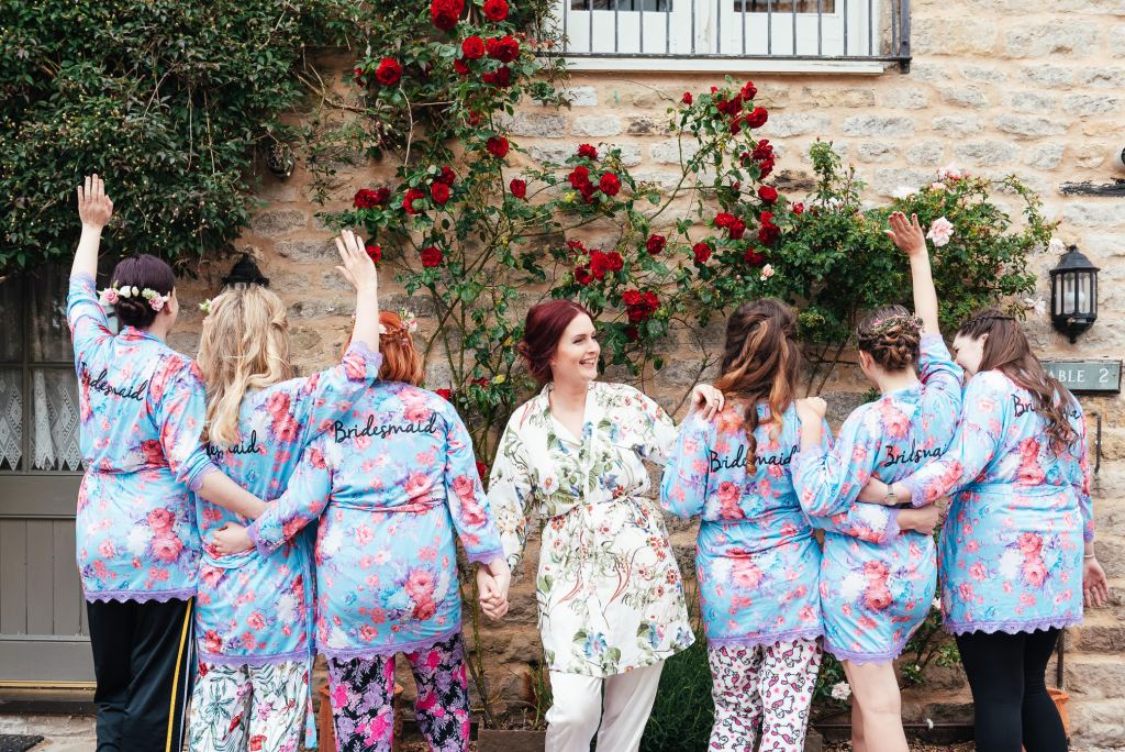 Bridesmaids and bride in matching floral dressing gowns