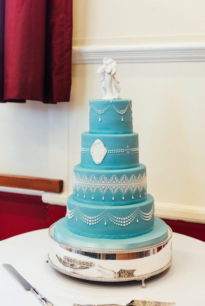 Beautiful embroidered wedding cake with blue icing