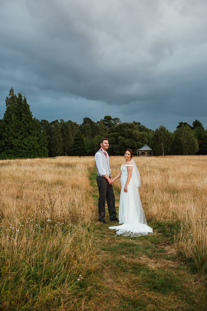 Dramatic sky with natural and candid couples portrait