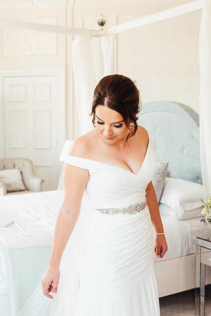 Elegant off the shoulder wedding dress on a glamorous bride