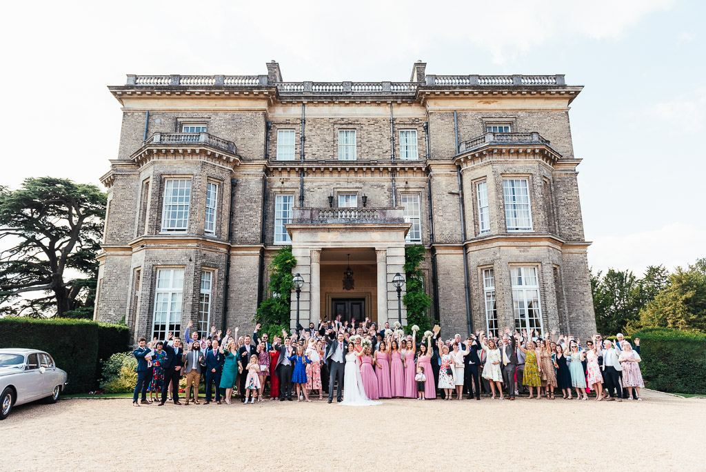 Group photograph of all the wedding guests at Hedsor House