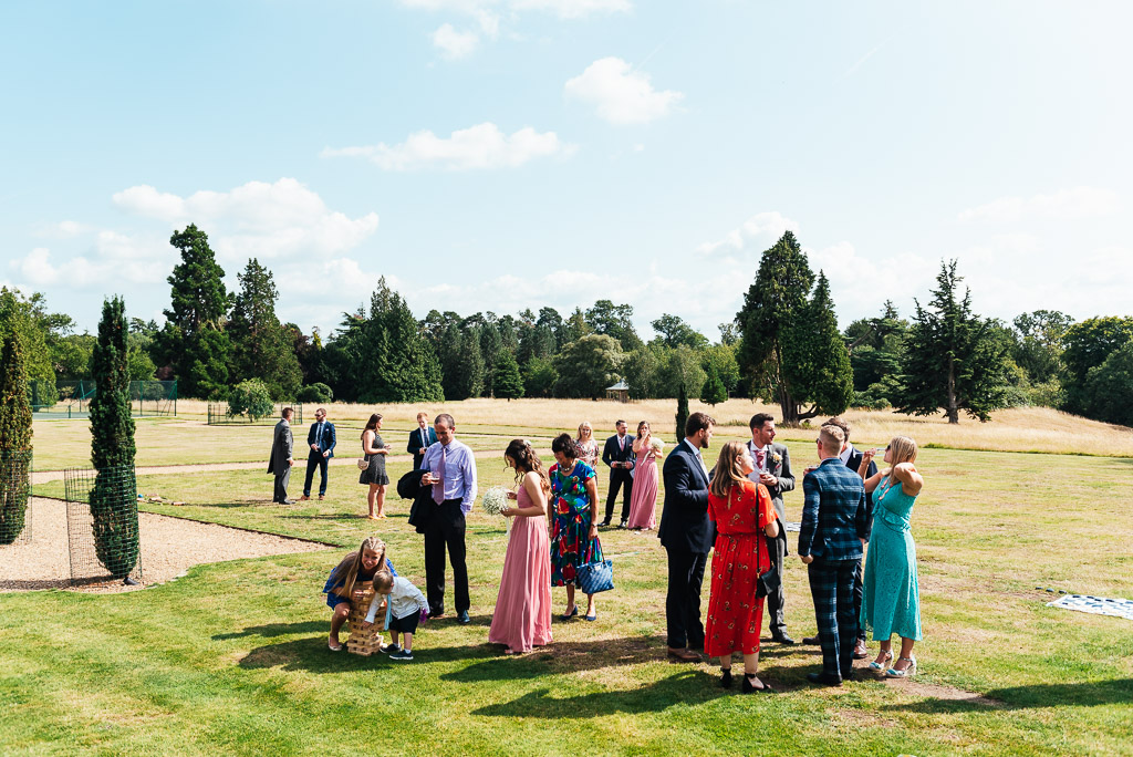 Relaxed and sunny garden reception at Hedsor House