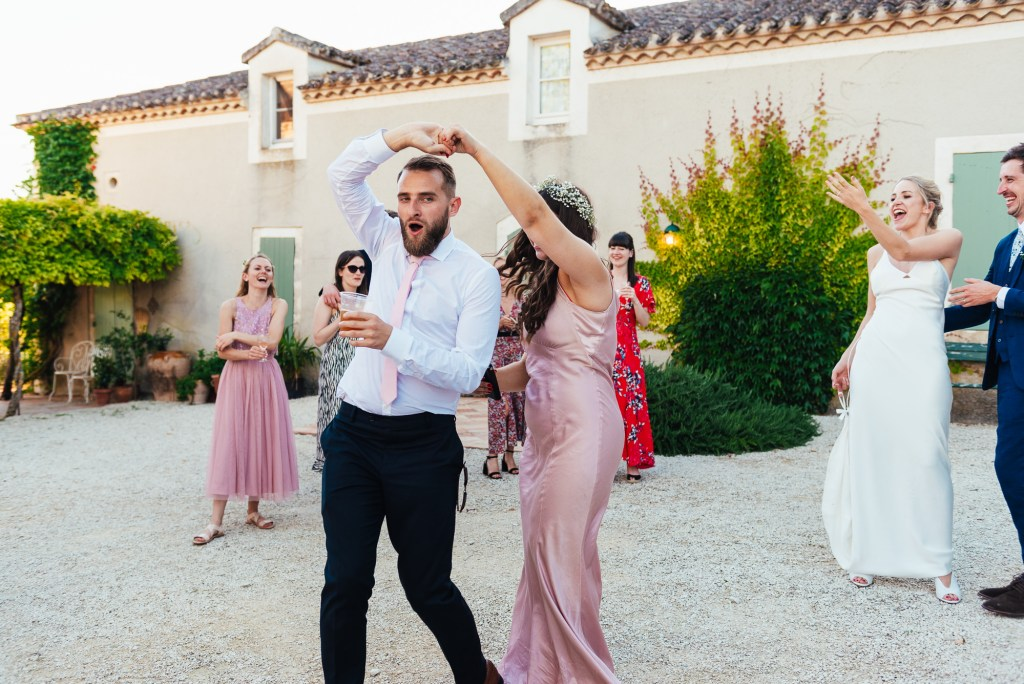Guests join in for first dance in French courtyard wedding