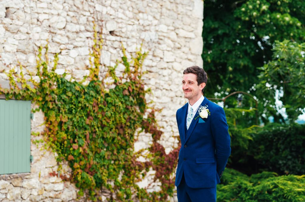 Groomsmen in gorgeous courtyard France, destination wedding photography