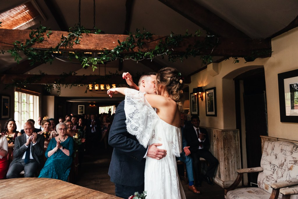 Couple share a romantic first kiss after saying I Do