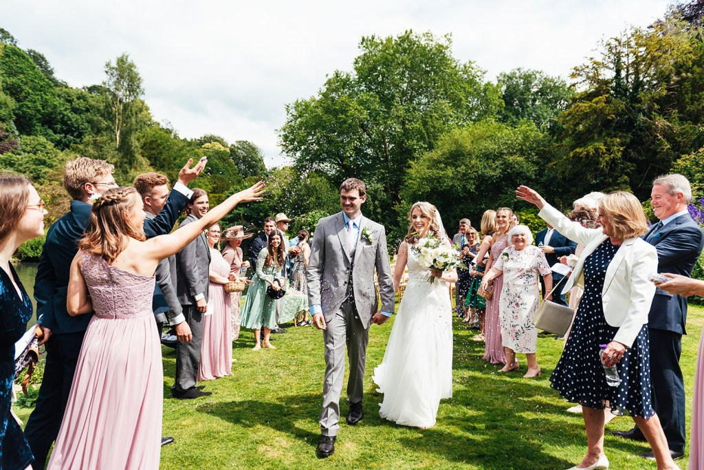 Outdoor wedding photography confetti line at Busbridge Lakes