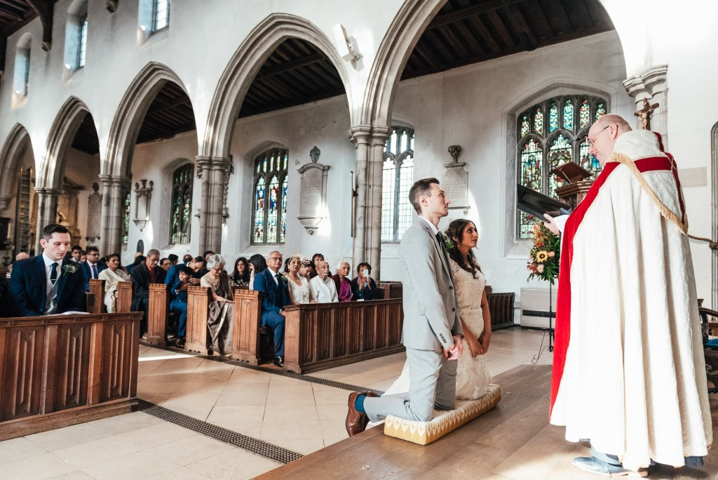 Vicar offers a blessing to the newly married couple