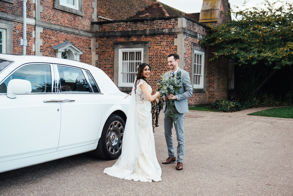 Couple arrive at Forty Hall for their reception