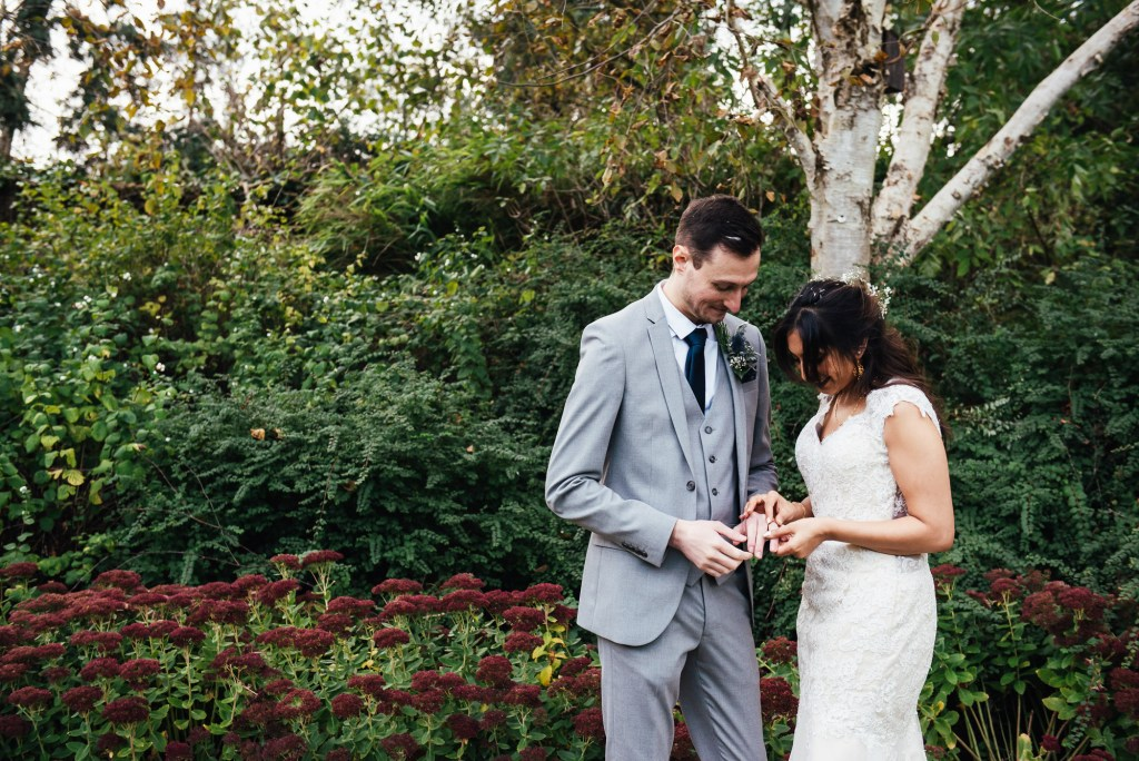 Cute couple admire their new wedding rings