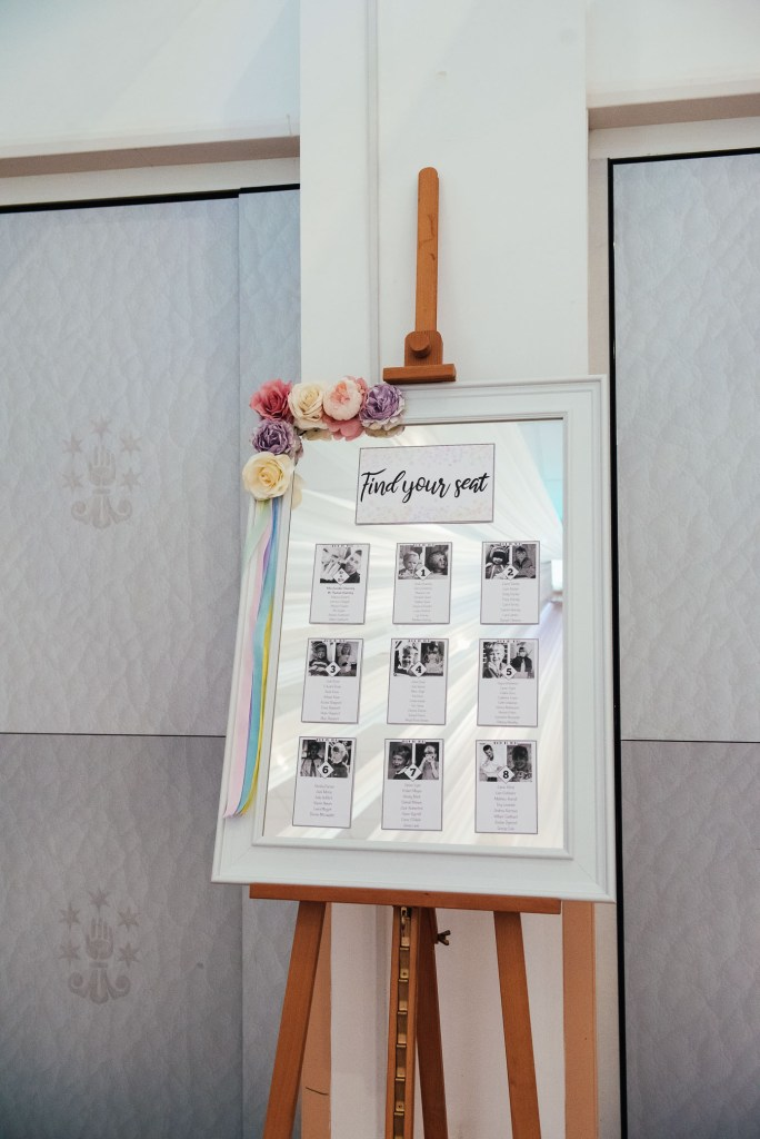 Handmade seating chart with mirror back ground