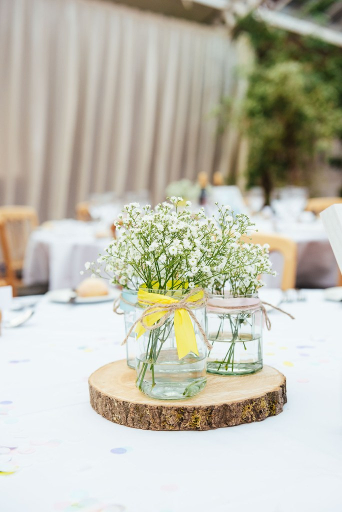 Chic and stylish wedding centre pieces filled with babies breath