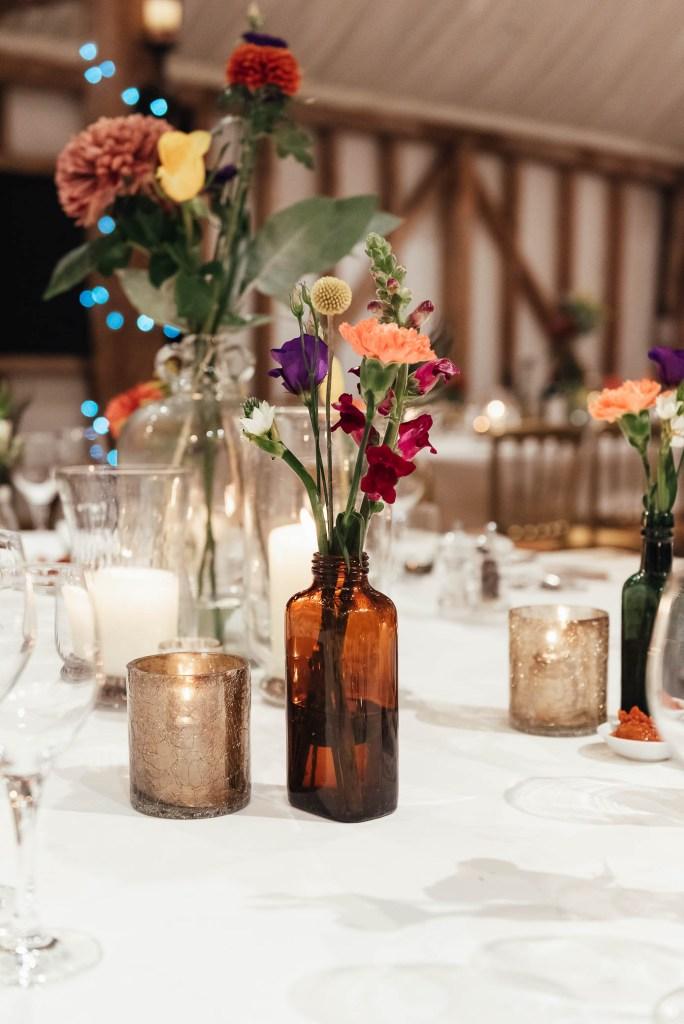 Vintage wedding bottles with delicate flower arrangement