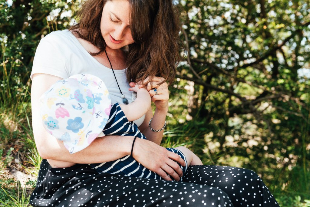 Natural and relaxed portrait of mother and baby breastfeeding