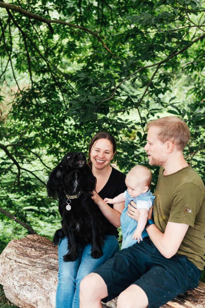 Outdoor newborn photography with pet dog