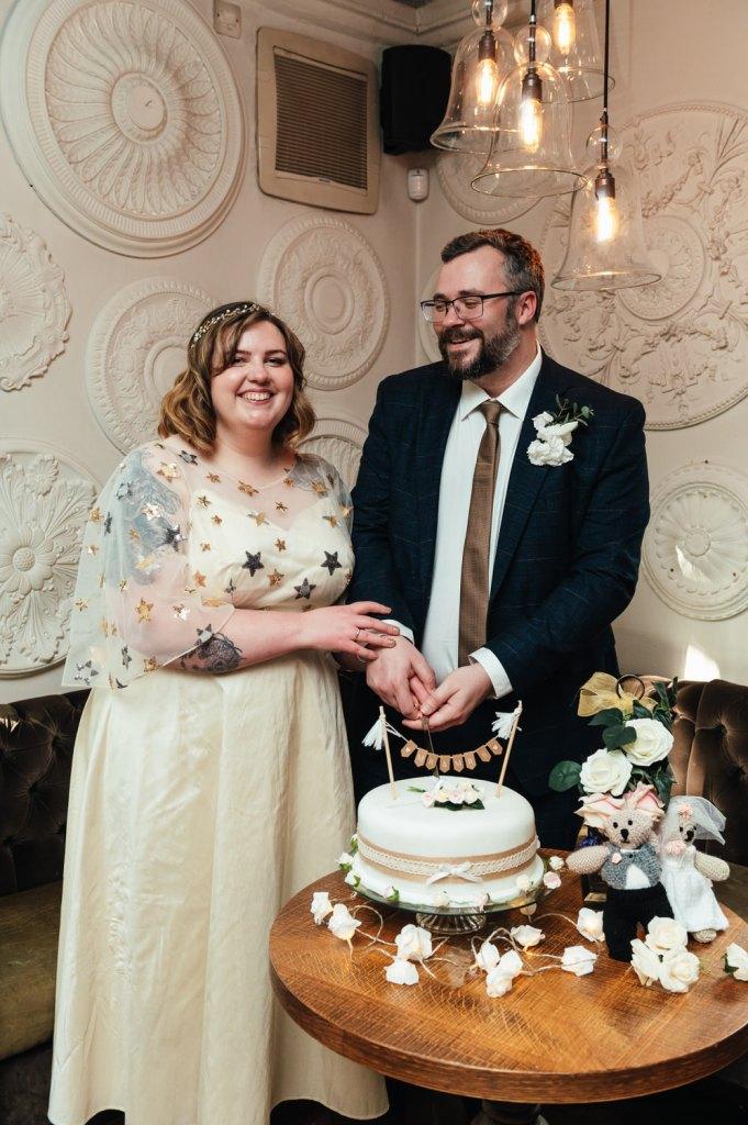 Weybridge Wedding Photography Cutting Cake