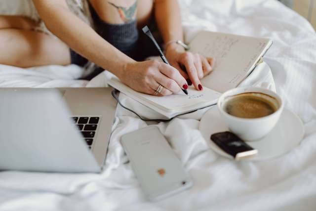 lady setting business goals to avoid blogging mistakes in her planner