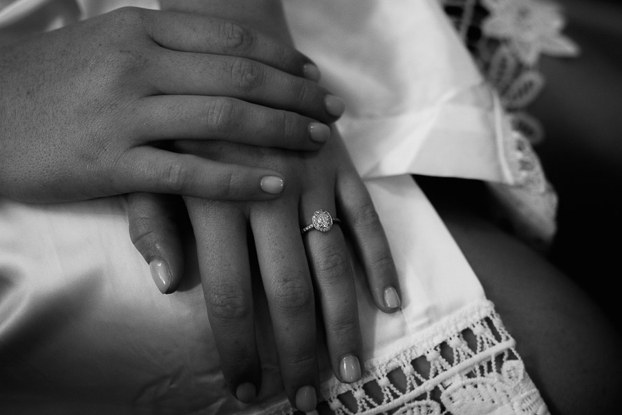 bride showing her engagement ring