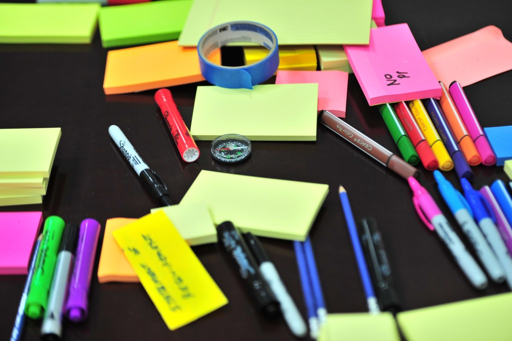 Photo by Frans Van Heerden from Pexels https://www.pexels.com/photo/photo-of-sticky-notes-and-colored-pens-scrambled-on-table-632470/