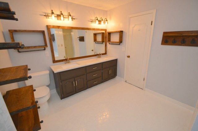 This bathroom renovation takes a drab room to a rustic-modern haven, and this post shares how we did it without breaking the bank. Painting the tile instead of getting new tile can save thousands of dollars.