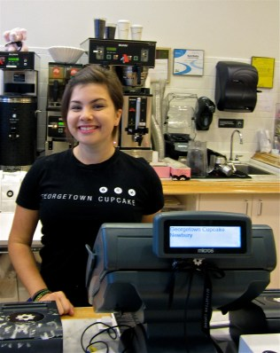"Allie Gilman has been working at Georgetown Cupcake Newbury for about two months. ""The milk chocolate cupcake is my favorite,"" she said."