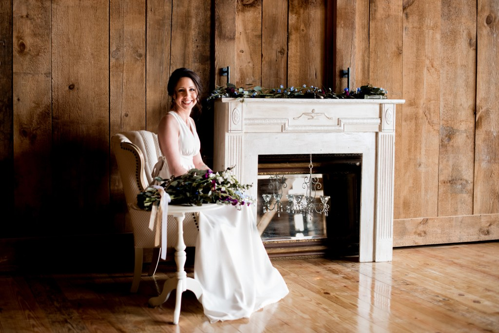 Jessica Patricia Photography Barn Bridal Portrait Seated at Mantle with Fresh Wrap Bouquet