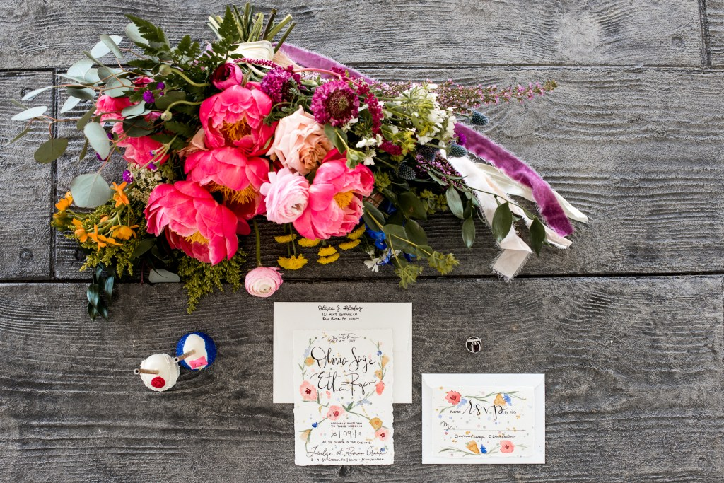Jessica Patricia Photography Styled Shoot Layflat at the Lodge at Raven Creek with Snapdragon Flower Co vibrant florals and Hands to Learn invitations and wedding cake pops from Dymonds by Kate
