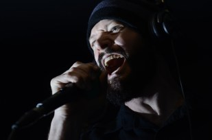 """Adam Arcane, band leader and business manager, sings the lyrics to Painted In Blood's original song, """"Zombies on Mars,"""" Monday, March 11, 2013 in his garage in Columbia, Mo. The band's LP is set for release no later than March 31, 2013."""