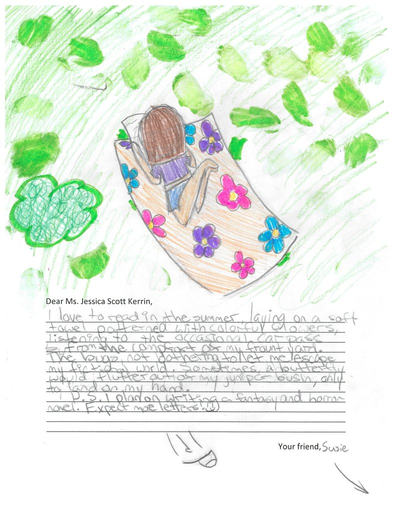 Child's drawing of a girl reading on a beach towel