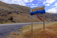 Wyoming State Welcome Road sign on interstate