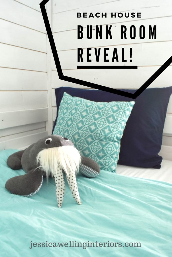 This fun ocean-themed beach house bunk room is the perfect vacation sleepover and play room for the kids. The Ikea bunk beds have ladders and built-in storage.  And this bunk even has a stuffed walrus.