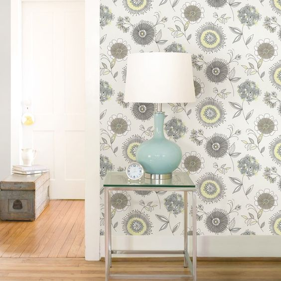 photo of white floral wallpaper with table and lamp