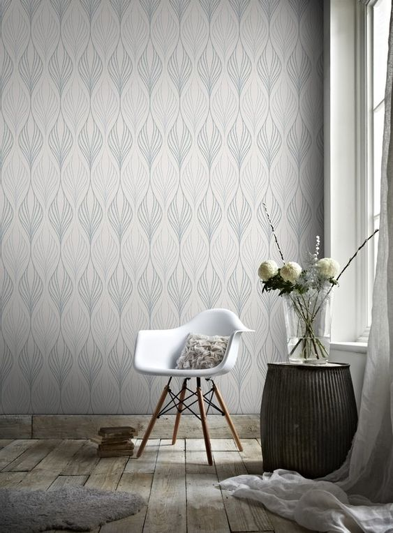 photo of white and grey wallpaper with white Eames armchair