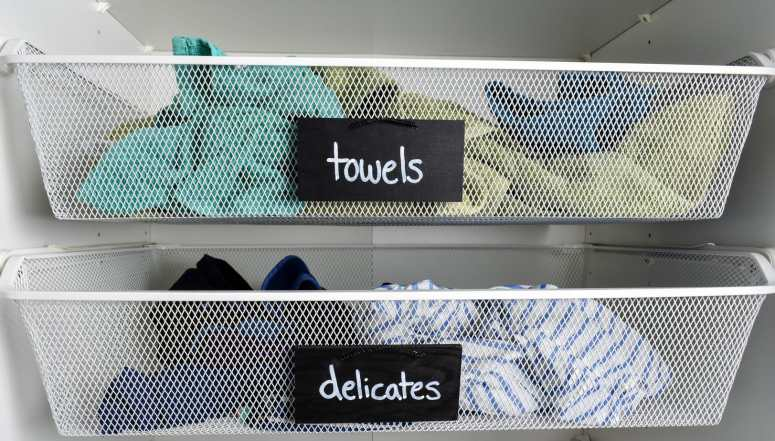 photo of laundry room with painted chalkboard labels